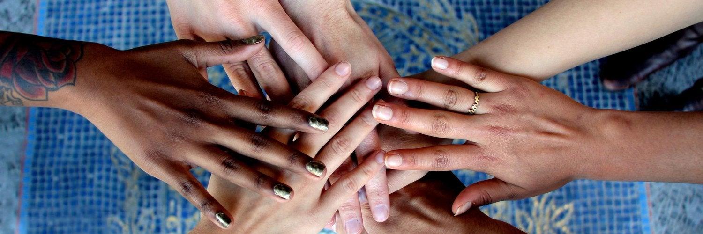 Seven hands together